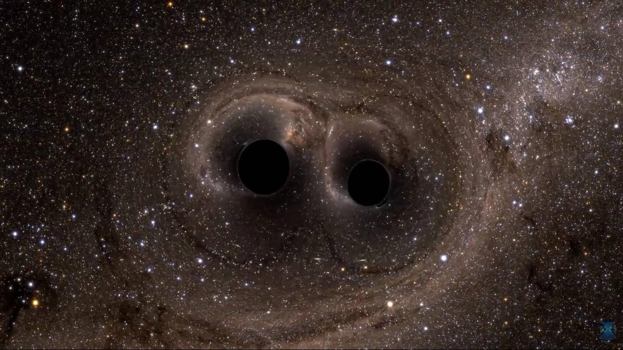Dos agujeros negros que se fusionan